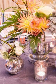 1950s Wedding Ideas | Confetti Daydreams - Striking silver floral decor vases ♥ I like the mix of textures