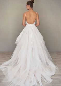 A beautiful elegant backless wedding dress to consider for a spring or summer estate wedding