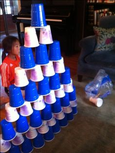 Getting Kids Active Indoors : Cup stacking can be played for speed or height. It can be a tool to design architecturally sound structures too! The best part is that you probably have disposable cups in your house. Any size will work. Mixing cups makes it more interesting and challenging.
