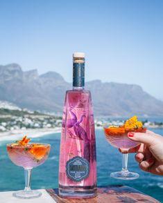 50ml Mirari Pink Gin 3-4 dashes Bitters Orange wedge & edible flower to garnish