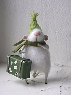 Withe felt muse with green hat and suitcase.