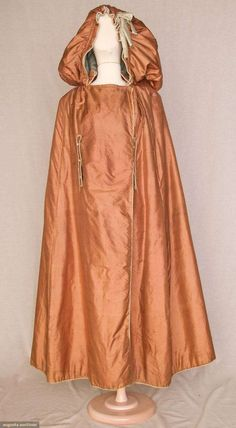 Silk hooded cape, piped in blue silk with blue silk buttons.  Note the oversized drawstring hood with blue silk lining.  circa 1760