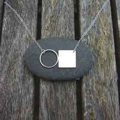 This is a simple design, all made with sterling silver. A wire circle has been soldered to a silver square and attached to a chain. The square has been given a brushed finish and together they are approximately wide and high. Wire Necklace, Simple Necklace, Wire Jewelry, Handmade Jewelry, Jewellery, Giraffe Jewelry, Black Jewelry, Geometric Jewelry, Small Earrings