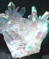 Angel Aura Quartz is also known as Opal Aura Quartz. It is a product of twentieth century technology, just as aqua aura, ruby aura and sunshine aura are. The beauty of these quartzes is immediately apparent as the 'new' technology enhances the extremely