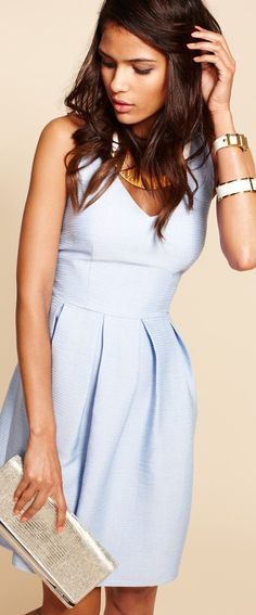 Cocktail dresses don't have to be black. We love this little blue number by Taylor