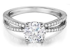 Check out this jaw-dropping Henri Daussi split shank diamond engagement ring, available in your choice of metals!!