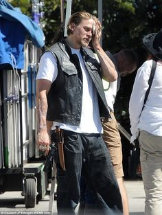 In character: Charlie Hunnam, 34, braved the heat as he filmed a scene for Sons of Anarchy on Tuesday