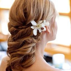 Cute hairstyle with two beautiful white flowers
