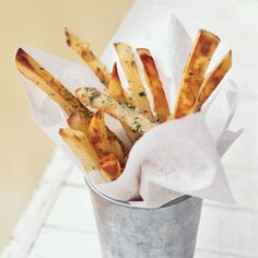 We first introduced this recipe in 2002, and it remains a favorite. Tossing crisp oven fries in a small amount of butter and garlic after...