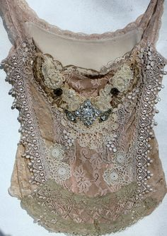www.rawrags.dk..Cute idea to make out of my taupe lace dress I refused to throw out for the past 30 years! WOW! Am I that old? It seemed like just yesterday when I bought it to wear to a friends wedding in the woods? Maybe use the other part for a ruffle on a skit out of some other pretty fabric then I would just need my granny boots!(Edwardian ones I like)