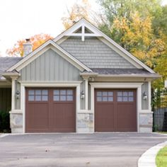 Love the bold white trim, dark garage doors, and combo of shakes and siding that are the same color.