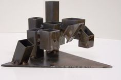 Desk organizer made of welded cut steel square tools