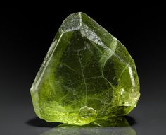 Peridot  Manshera, Naran-Kagan Valley, North-West Frontier Province, Pakistan   Such large and gemmy crystals of cutting quality are now exceedingly rare in the mineral market. The present specimen displays well-formed primary and secondary faces and a high degree of transparency: most are murky and/or rounded. Measuring 3.5 x 3.5 x 1.5cm
