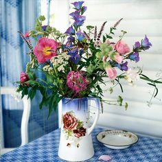 Vintage vase with wild flowers