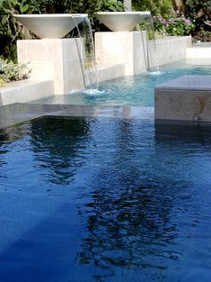 Contemporary Limestone Urn Pool Spillways, Essex Bowls with notched (on site) section. Love this design!