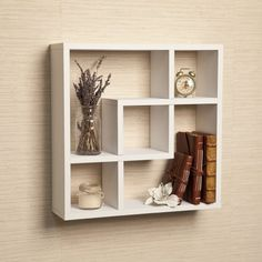Geometric Square Wall Shelf with 5 Openings Danya B http://smile.amazon.com32.95 & FREE Shipping Only 15 left in stock. Ships from and sold by Home Trends Online. Eligible for AmazonSmile donation.  Estimated Delivery Date: June 11 - 16 when you choose Standard at checkout.      ■Dimensions: 17.75 inches high x 17.75 inches wide x 5 inches deep     ■Materials/Color: Laminated MDF/White     ■Easy to clean white finish laminate     ■No visible hanging hardware, all hardware included     ■Minor…