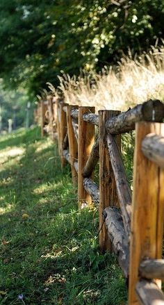 Love this. . . rustic log fence