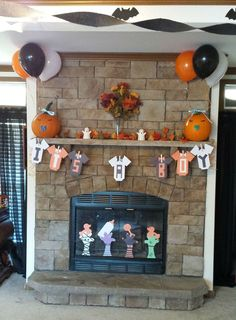 "DIY Halloween Themed Baby Shower Decor Ideas. I made the ""It's A Boy"" sign & scary hands coming out of the fire place with construction paper."