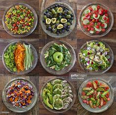carrots, tomatoes, radicchio, radishes, olives, corn, celery, mushrooms, avocado, spinach, smith apple, pine nuts, chives, basil, zucchini, endive
