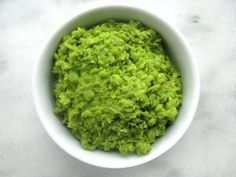 Mushy Peas Recipe - peas are cooked simply with butter, then mashed and seasoned with lemon, salt and pepper. The result is a simple bright side dish that comes together in no time at all, and adds vivid color and light flavors to any plate. Hp Sauce, Scottish Recipes, Irish Recipes, Fish And Chips, Pea Recipes, Cooking Recipes, Healthy Recipes, Simply Yummy, British Dishes