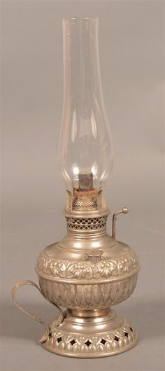 I just discovered this Nickel Plated Brass Small Kerosene Lamp. on LiveAuctioneers and wanted to share it with you: www.liveauctioneers.com/item/46454237