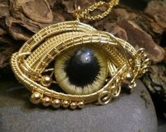 Gothic Steampunk Golden Evil Eye Pendant with Gold Beads