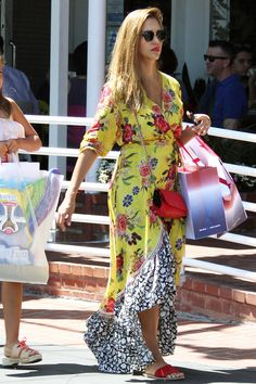 Jessica Alba wearing Chanel Red Quilted Lambskin Classic Wallet on Chain, Ancient Greek Sandals Taygete Sandals, Farm Rio Sunlit Floral Maxi Dress and Ray-Ban Rb4246 Clubround Sunglasses