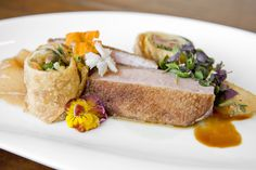 Duck Duet: seared breast, Asian pear butter, roasted vinegar glace, confit spring roll