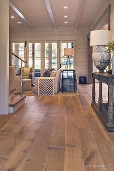 Wide Plank White Oak Hardwood Floor By Oak And Broad With Custom Stain | View Into Living Room Of Charming Southern Home | Discover more at http://OakAndBroad.com/nashville-tennessee-wide-plank-white-oak-flooring/