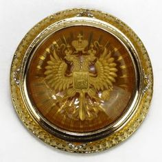 """FABERGE IMPERIAL BRASS AND CRYSTAL PAPER WEIGHT. Measures 3"""" in diameter. With the imperial sign embossed in gold. Signed Faberge comes in original Faberge box ."""