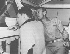 Jim Morrison with his father George S. Morrison on the bridge of the USS Bon Homme Richard, January 1964.