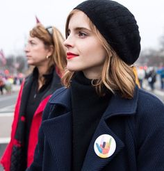 Emma Watson in the #PincauseLOVE pin at the Women's March on Washington. This pin supports Planned Parenthood and ACLU.