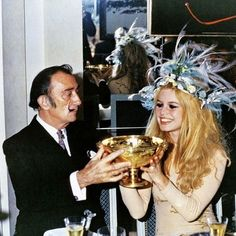 Bridget Bardot and Salvador Dalí. With a cocktail in hand you need a dress code to match!
