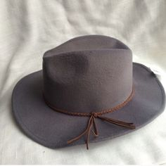 NWT Structured Gray Fedora Hat Brand new with attached tags. Has wire in brim to help shape it how you'd like. Retail $29.99. Accessories Hats
