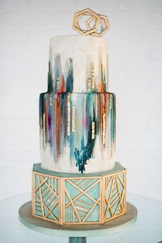 A beautiful Ikat-style wedding cake with gold accents.