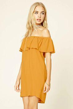 74e5a181ddc A woven shift dress featuring an off-the-shoulder collar, flounce layer,