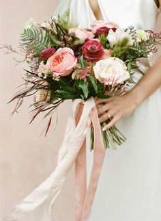 watercolor vibes of that stunning bouquet & ribbon! Anemones, ranunculus and roses – in varying shades of pink.