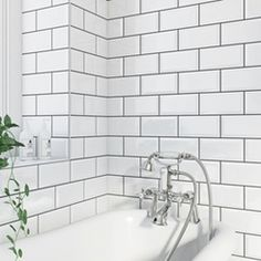 White metro tiles for the bottom half of wall or entire wall for bath/shower, grey grout, grey paint above Metro white bevel gloss tile 100mm x 200mm