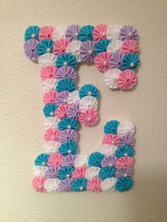 "Custom Wood Letters - Baby Name or Initial Letters - 9"" Wooden Letter covered with fabric yo-yos can hang on door or wall on Etsy, $22.50"