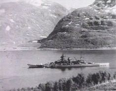 11 in German battleship Scharnhorst in Langfjord, Norway: the camouflage scheme dates this picture to summer 1943, which was to be her last - the Royal Navy sank her whilst she was attempting to intercept an Arctic convoy on Boxing Day that year in a purely surface action, with no air involvement.