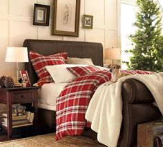Christmas plaid in a cozy bedroom. The tree must smell wonderful.