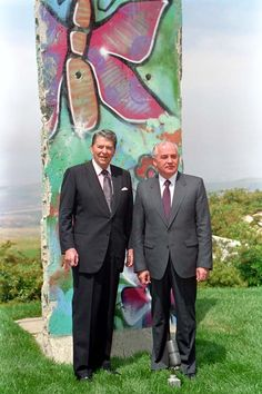 President Ronald Reagan poses with Mikhail Gorbachev by the piece of the Berlin Wall at Library. 5/4/92.