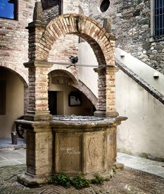 #Castello #di #Velona #Farmhouse #Castle #Old #Italy #Tuscan #limestone #wall cladding #fireplace #poolfountain