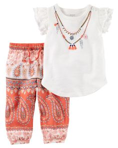 Featuring flutter sleeves and pretty printed joggers, this warm weather combo has her dressed in a breeze.