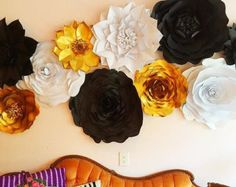 You are looking at a listing for a Set of 20 Paper Flowers You will receive: 6 Small Tissue Paper Pom Poms 5 Small Flowers (12-14) 7 Medium Flowers (15-18) 2 Large Flowers (19- 20 ) Display photo features 20 White & Gold Paper Flowers displayed in an elegant arrangement creating an enchanting & whimsical archway. Your quest will be in awed over and your photos of that first kiss will be most memorable!  Flowers are designed from a heavy weight craft paper and are created in various ty...