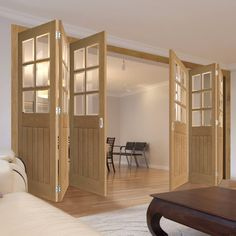 Thrufold Ely Oak 3+3 Folding Door - Clear Bevelled Glass -Unfinished - Lifestyle Image.    #oakinternalglazeddoors #doors #foldingdoors #internalfoldingdoors #bifold