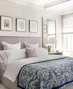 Tom azul, destaque nessa cama linda, detalhe para os quadros