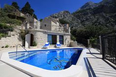 Holiday House Dalmatian Stone with Swimming Pool is situated in Makarska, which has a great view at the sea and the islands.