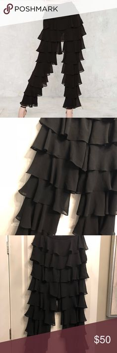 Lavish Alice ruffle pants. Lavish Alice black ruffle leg pants size L. In perfect condition. These sold out quick! From nasty gal. No trades. Nasty Gal Pants