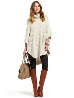 Love the poncho. Probably wouldn't wear it in white, but it'd be great in another color. Good boots, too!
